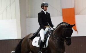 Lucy Straker in dressage arena